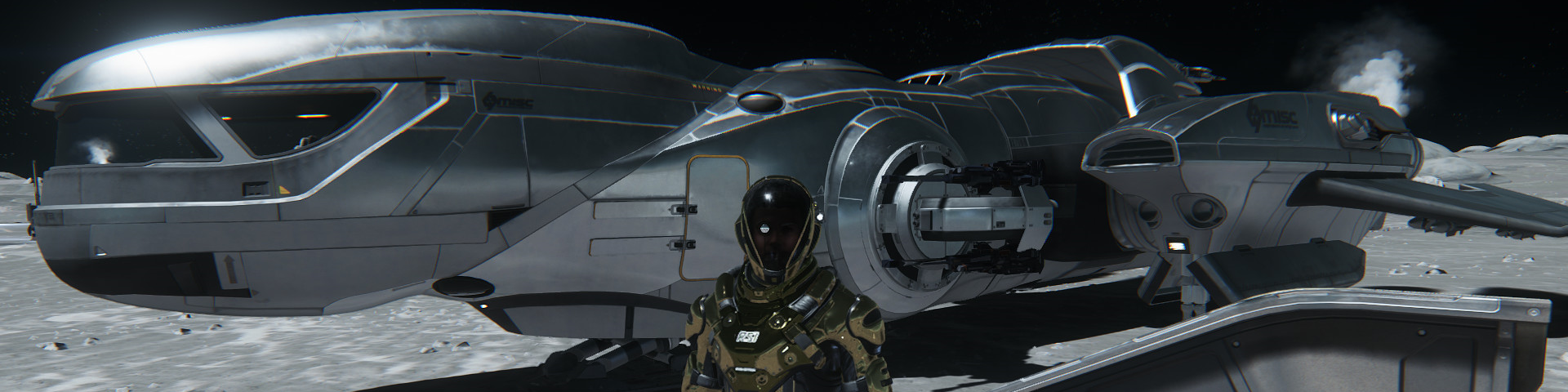A man standing in front of a landed heavy shuttle.